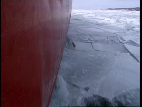 cu, hull of ship traveling forward through icy water, lake michigan, michigan, usa - hull stock videos & royalty-free footage