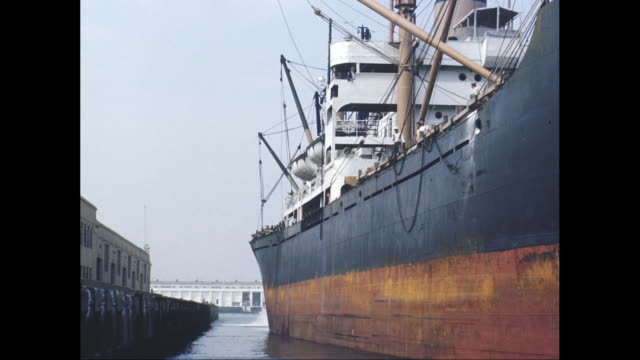 WS Hull of ship unmoors from dock in harbor / United States