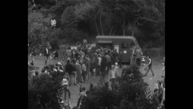 vídeos de stock e filmes b-roll de a human bein was staged in golden gate park on the summer solstice of 1967 summer of love / a food truck fed festival attendees - love in