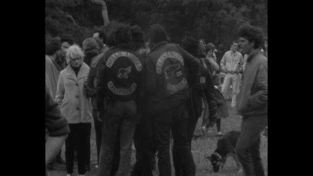 vídeos de stock e filmes b-roll de a human bein was staged in golden gate park on the summer solstice of 1967 during summer of love / rock and roll bands hippies dogs sailors and hells... - love in