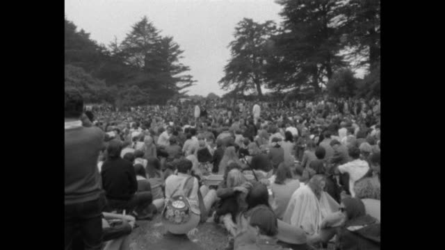 vídeos de stock e filmes b-roll de a human bein was staged on the summer solstice of 1967 during the summer of love / rock and roll bands hippies dogs sailors and hells angels were in... - love in
