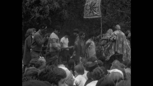 vídeos de stock e filmes b-roll de a human bein was staged on the summer solstice of 1967 in golden gate park / people danced to psychedelic rock music performed by quicksilver... - love in