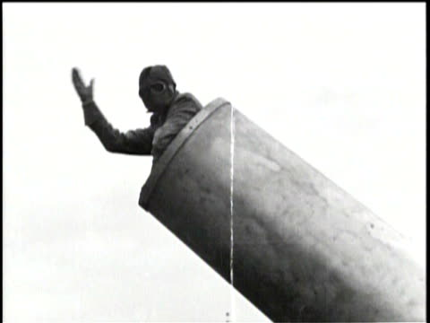 / human cannon on coney island / a man climbs into a large cannon for an act / he waves to the audience before dropping into it / he is shot out of... - artillery stock videos & royalty-free footage