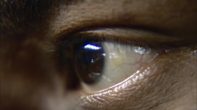 ecu human eye blinking / india - unknown gender stock videos & royalty-free footage