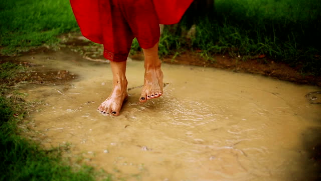 human feet and puddle - monsoon stock videos & royalty-free footage