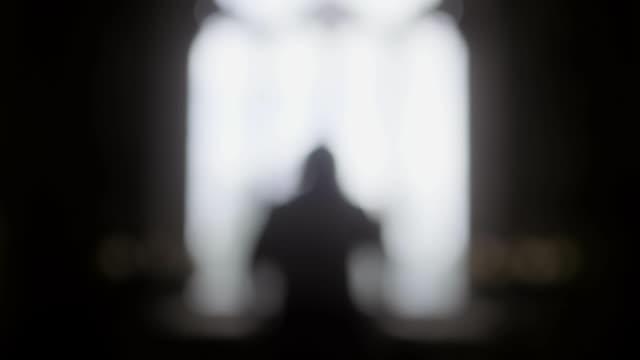 human figure walks towards window - silhouette stock videos & royalty-free footage