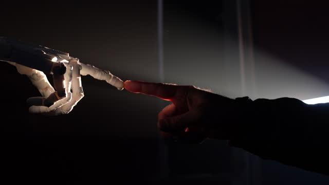 vídeos de stock e filmes b-roll de human finger touching robot fingers - human finger