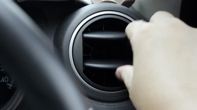 human hand adjusts car air conditioner vent direction - air conditioner stock videos & royalty-free footage