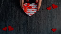 Human hand and gift for Valentine's day