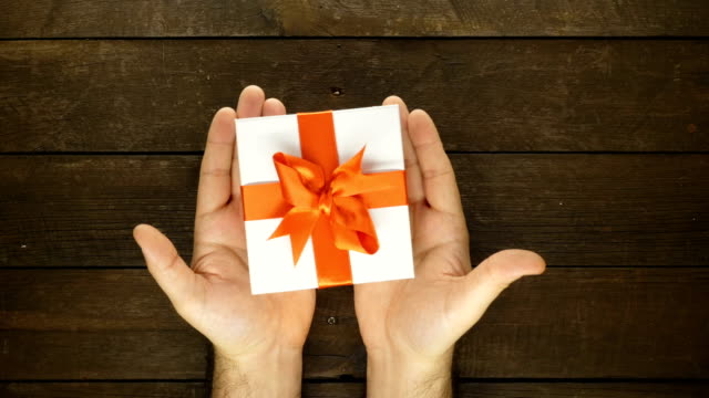 human hand and gift with stop motion animation - birthday gift stock videos & royalty-free footage