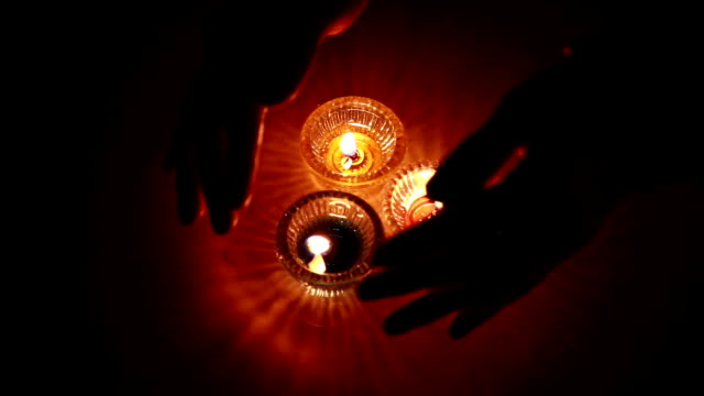 Human hand and oil lamp