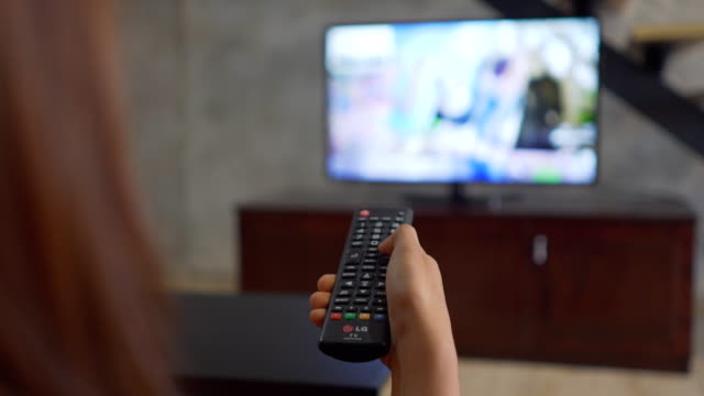 human hand changes the channels on the tv remote control - changing channels stock videos & royalty-free footage