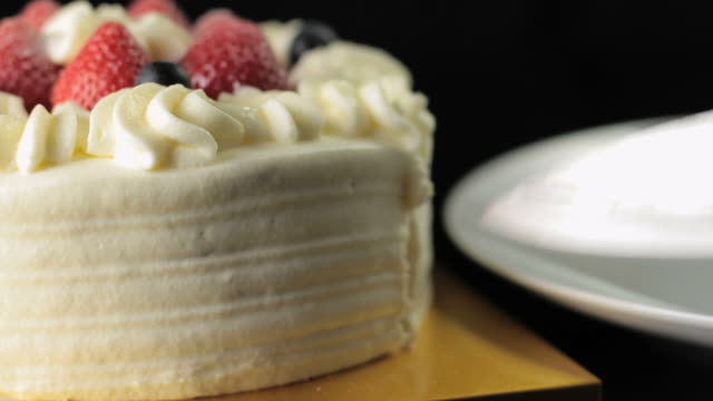 cu slo mo human hand cutting slice of cake / new york city, new york, usa. - cake stock videos & royalty-free footage