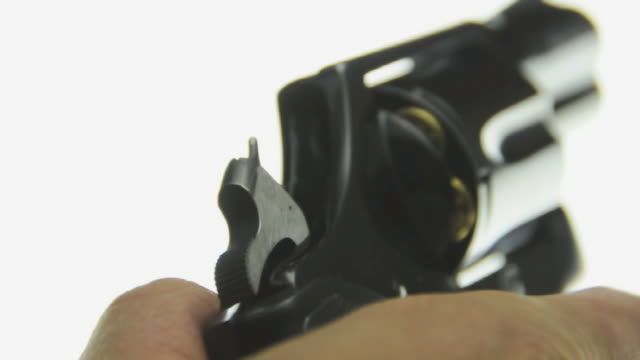 ECU Human hand demonstrating the hammer action and cylinder rotation initiated by trigger pull / Los Angeles, California, USA