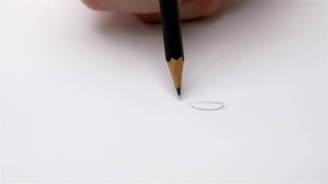 human hand drawing wooden pencil writes on paper shot - pencil stock videos & royalty-free footage