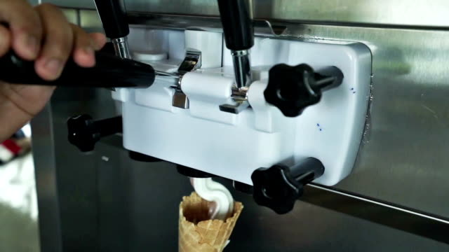 human hand holding cone with twisted ice cream from machine - ice cream cone stock videos and b-roll footage