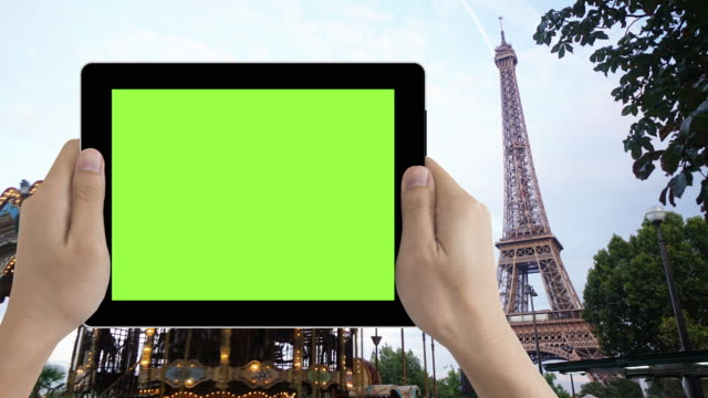 human hand holding green screen tablet in paris tourist location - france stock videos & royalty-free footage
