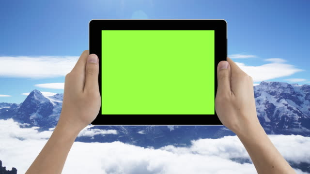 human hand holding green screen tablet in switzerland tourist location - template stock videos and b-roll footage