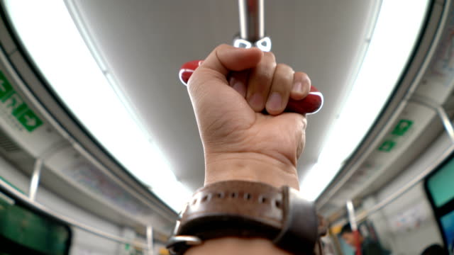 pov human hand holding handrail or grip straps in subway or train - gripping stock videos and b-roll footage