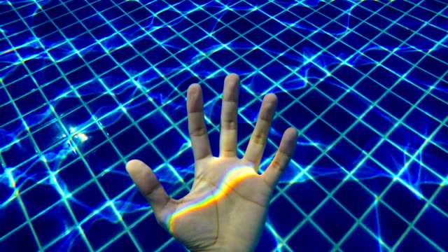 human hand in swimming pool with rainbow water reflection - spectrum stock videos and b-roll footage