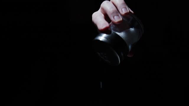 human hand is sprinkling salt from the salt shaker - sprinkling stock videos & royalty-free footage