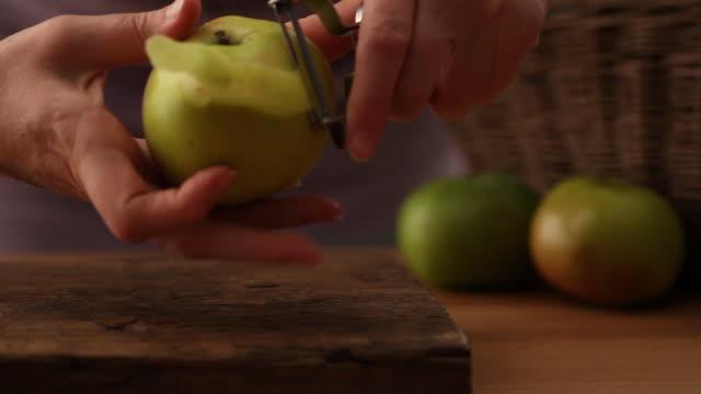 cu zi human hand peeling apple / london, uk - peeling food stock videos & royalty-free footage