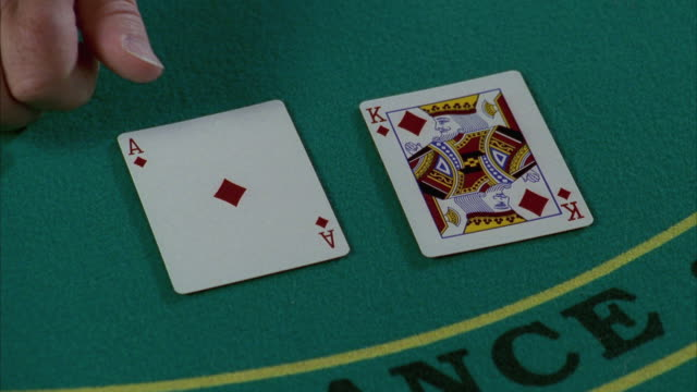 cu human hand placing ace and king cards on blackjack table / las vegas, nevada, usa - blackjack stock videos and b-roll footage