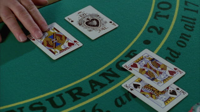 cu human hand placing cards on blackjack table / las vegas, nevada, usa - blackjack video stock e b–roll