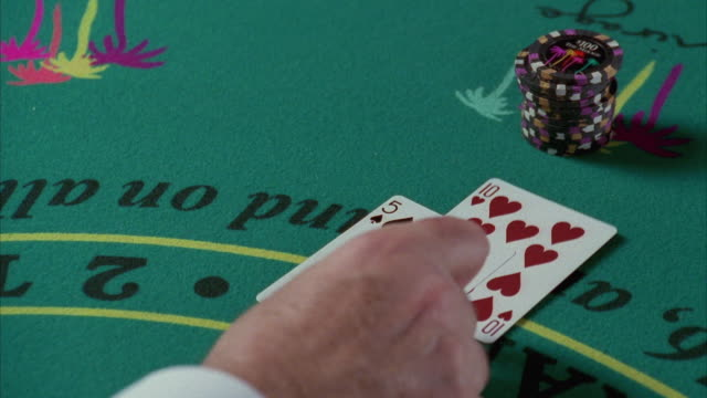 cu human hand placing cards on blackjack table / las vegas, nevada, usa - gambling chip stock videos and b-roll footage