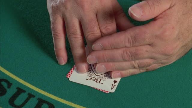 cu human hand placing cards on blackjack table / las vegas, nevada, usa - blackjack stock videos and b-roll footage