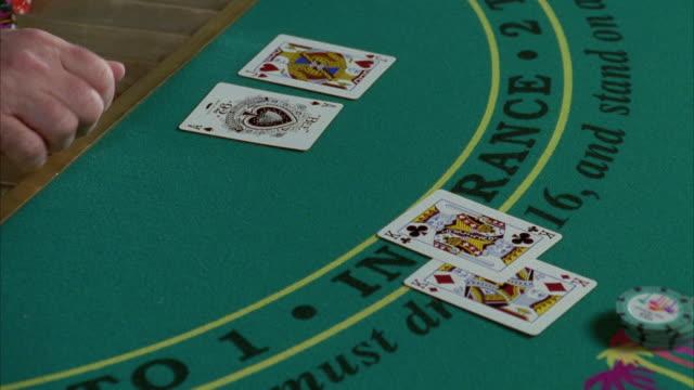 cu human hand placing cards on blackjack table - blackjack stock videos and b-roll footage