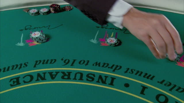 cu human hand placing gambling chips on blackjack table / las vegas, nevada, usa - gambling chip stock videos and b-roll footage