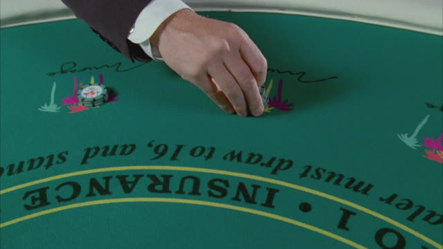 cu human hand placing gambling chips on blackjack table / las vegas, nevada, usa - blackjack stock videos and b-roll footage