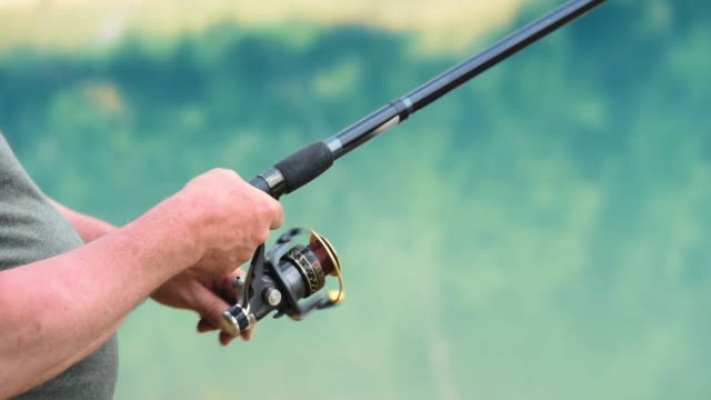 human hand/ polanczyk/ poland - fishing reel stock videos and b-roll footage