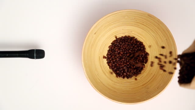 CU Human hand pouring Coffee Bean in bowl and microphone recording something / Seoul, South Korea