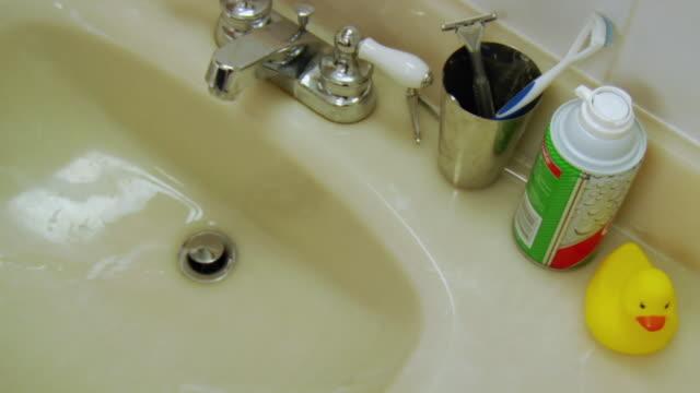 cu human hand putting shaving cream on toothbrush / brooklyn, new york, usa - razor stock videos & royalty-free footage