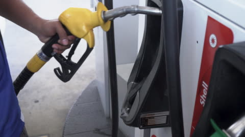 human hand refueling at gas station - petrol stock videos & royalty-free footage