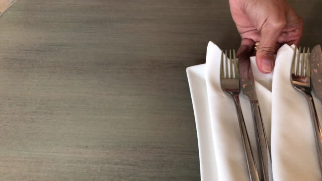 human hand serving plates with eating utensils and bowls with ketchup and mayonnaise and salt and pepper shaker - salt shaker stock videos and b-roll footage
