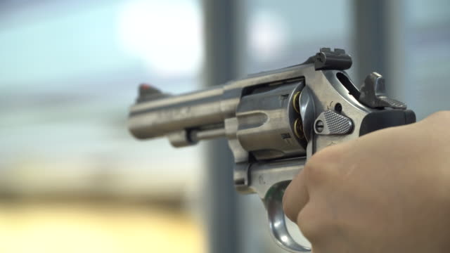 human hand shooting gun - gun barrel stock videos & royalty-free footage