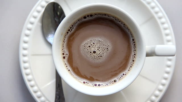 human hand take hot coffee in white cup for drink - stirring stock videos & royalty-free footage