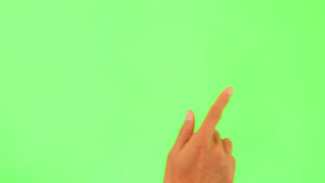Human hand touching green Screen