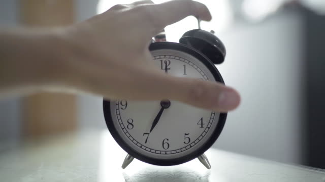 human hand turn off alarm clock at seven o'clock in the morning - napping stock videos & royalty-free footage