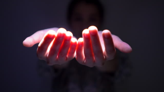 human hand with light of god - catching stock videos & royalty-free footage