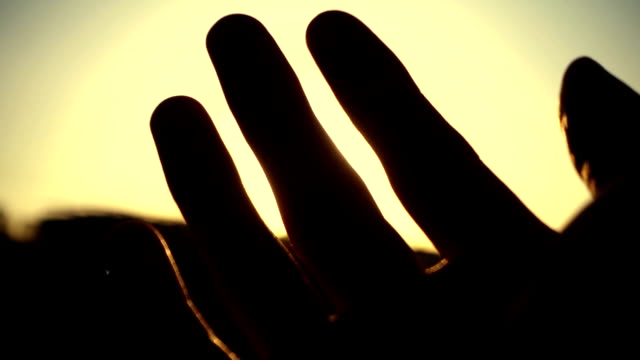 human hand with light of sun - god stock videos & royalty-free footage