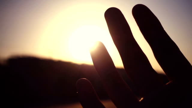 human hand with light of sun - brightly lit video stock e b–roll