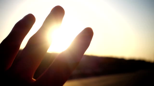 human hand with light of sun - religious celebration stock videos & royalty-free footage