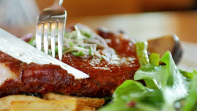human hands cutting beef steak - steak stock videos & royalty-free footage