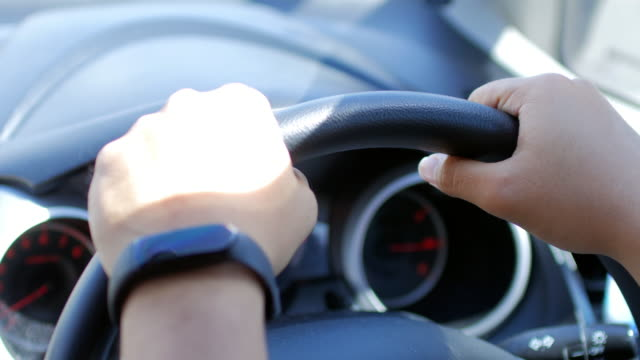 human hands drive a car - gripping stock videos and b-roll footage