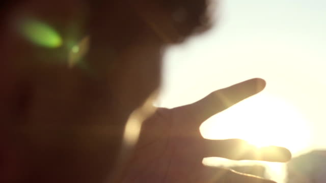 human hands playing with sunbeams during sunrise - light natural phenomenon stock videos & royalty-free footage