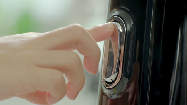 vídeos de stock, filmes e b-roll de human hands push the button of blender - pushing